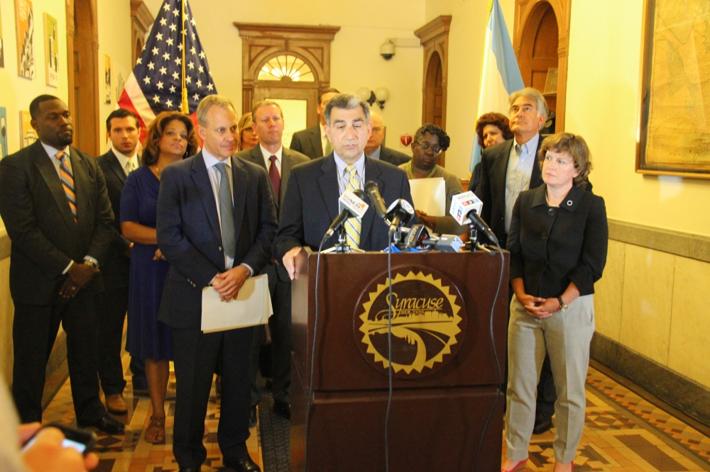 Assemblyman Magnarelli was part of an event celebrating the passage of legislation to prevent people from losing their homes through foreclosure and to address the problem of unoccupied and ill-mainta