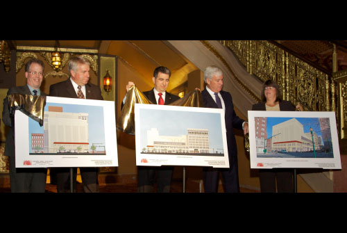 The Landmark Theatre marked the beginning of a $16 million renovation that will turn the 1928 ornate theater into a performing arts center. William Fisher, Deputy County Executive, Onondaga County; John Cowin, Deputy Mayor, City of Syracuse; Assemblyman Magnarelli; Bill James Breuer, President, Hueber-Breuer Construction; and Paula Deckman, Landmark Theatre Board Chair, unveil posters of the planned renovations.