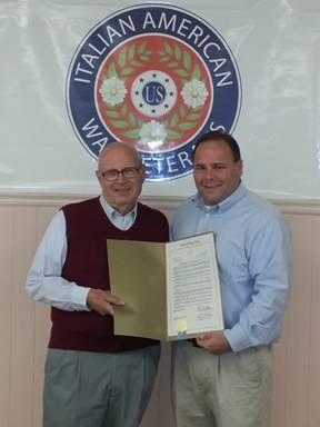 Assemblyman Palmesano presents the resolution honoring the 100-year anniversary of the Corning Marconi Lodge to Lodge President William Crane, Sr.