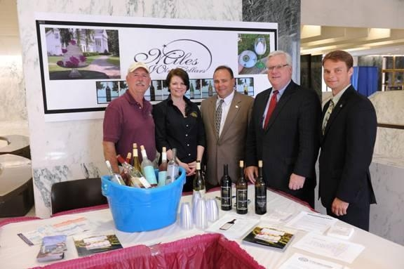 Scott Osborn, President of Fox Run Vineyards; Suzy Hayes of Miles Wine Cellars; Assemblyman Phil Palmesano (R,C,I-Corning); Sen. Tom O'Mara; and Assemblyman Christopher S. Friend (R,C,I-Big Flats) at the NYS Wine and Cheese Tasting Reception.