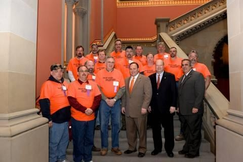 Local town highway superintendents from Steuben County in orange shirts with Assemblyman Palmesano (left, orange tie) Assemblyman Bill Nojay (center) and Assemblyman Joe Giglio (right).