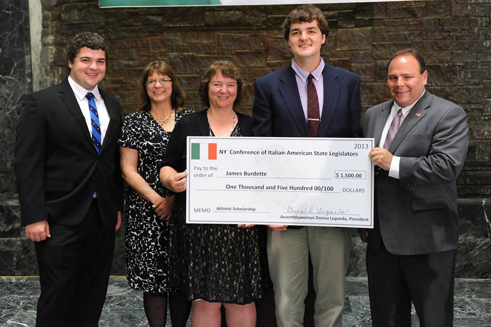 Palmesano with 2013 scholarship winner James Burdette and his family. He accepted a scholarship to attend SUNY Albany.<br />