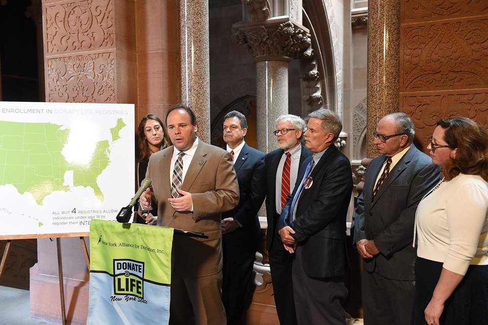 The attached photo depicts Assemblyman Palmesano speaking last year at a press conference with his legislative colleagues, organ donor advocates and donor families.