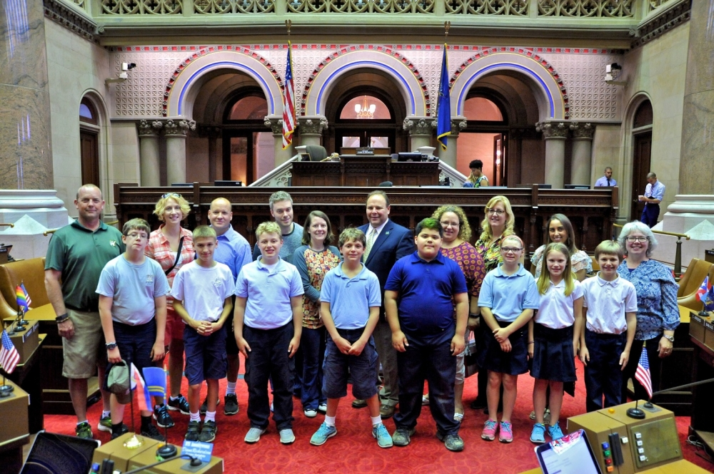 Palmesano pictured with students and parents from Keith Prather's fifth-grade class at St. Michael School in Penn Yan. The photo was taken in the Assembly Chamber.