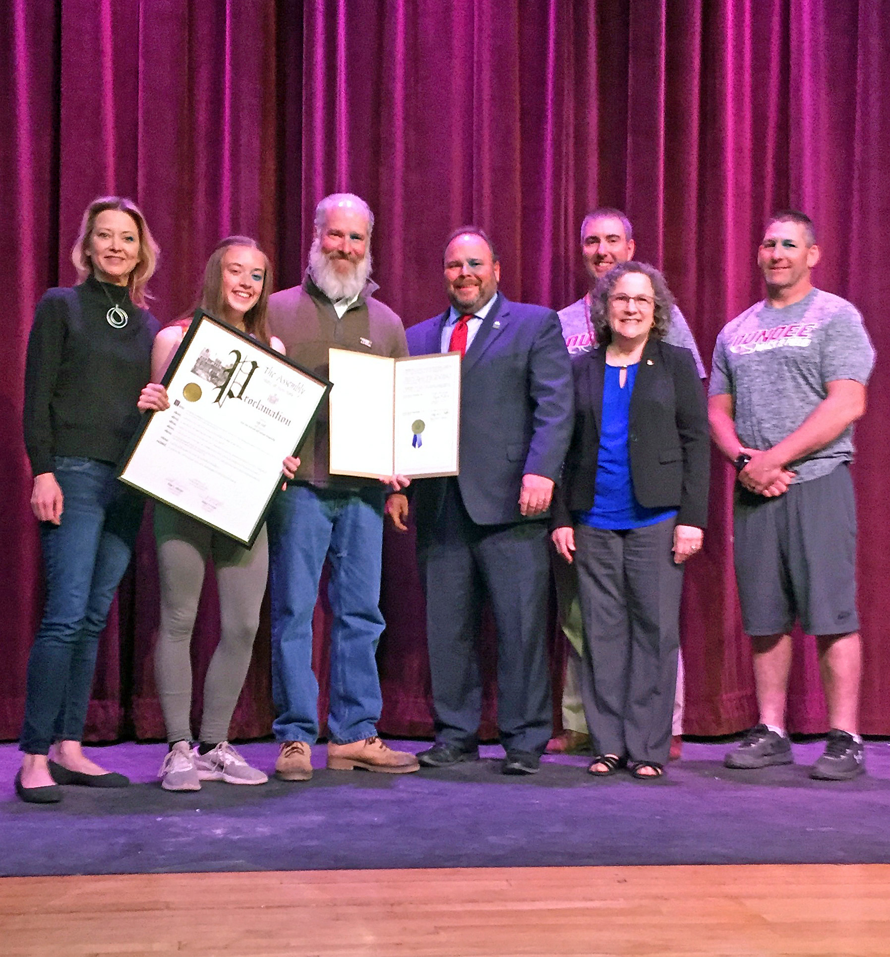 From left to right: Macy Hall, Lily's mother, Lily, Lily's father William Hall, Assemblyman Palmesano, Varsity Boys' Track Coach Scott Shepardson, Sharon Sitrin-Moore, and Varsity Girls