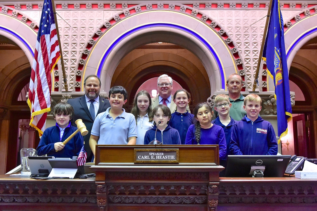 Assemblyman Palmesano, Senator O'Mara and teacher Keith Prather join the students on the rostrum in the Assembly Chamber.
