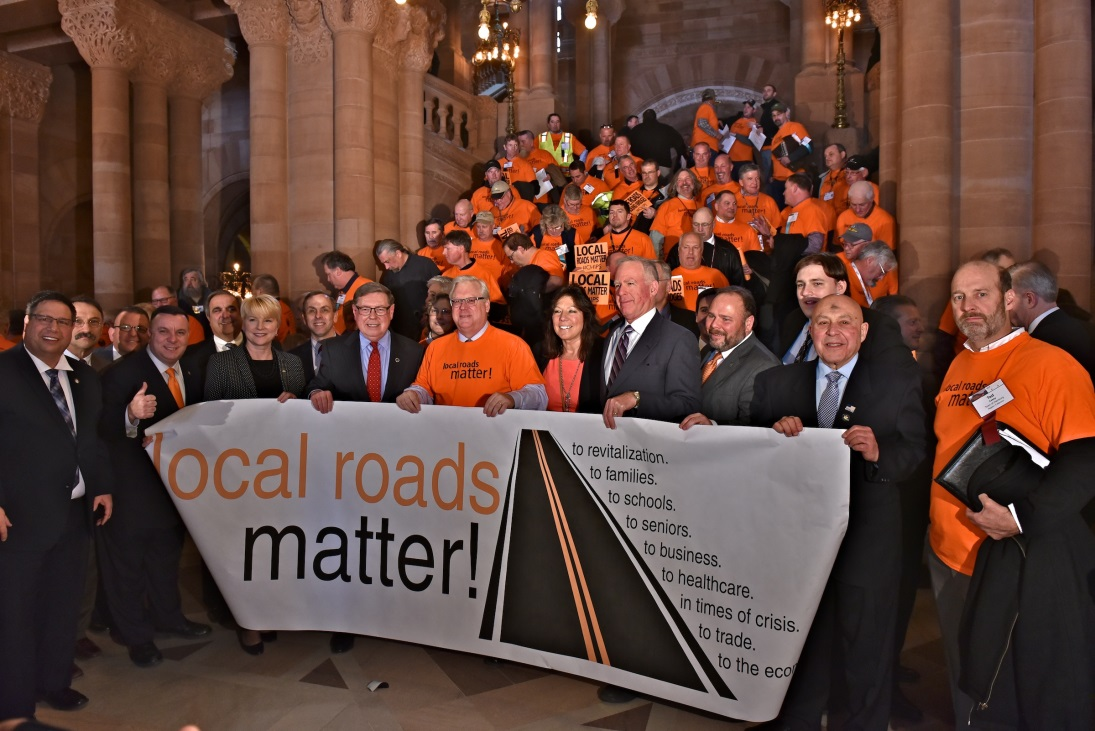Assemblywoman Marjorie Byrnes (R,C-Caledonia) alongside highway workers on Wednesday, March 6.