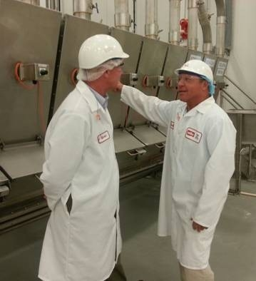 Kevin Williams, vice president of Supply Chain at the Muller Quaker Dairy yogurt facility, and Assemblyman Steve Hawley discuss the facility's operations.