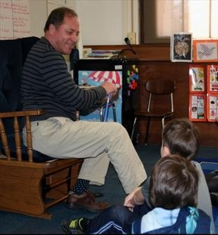 Assemblyman Steve Hawley (R,C,I-Batavia) reads to children at Churchville Elementary in honor of Read Across America Day.