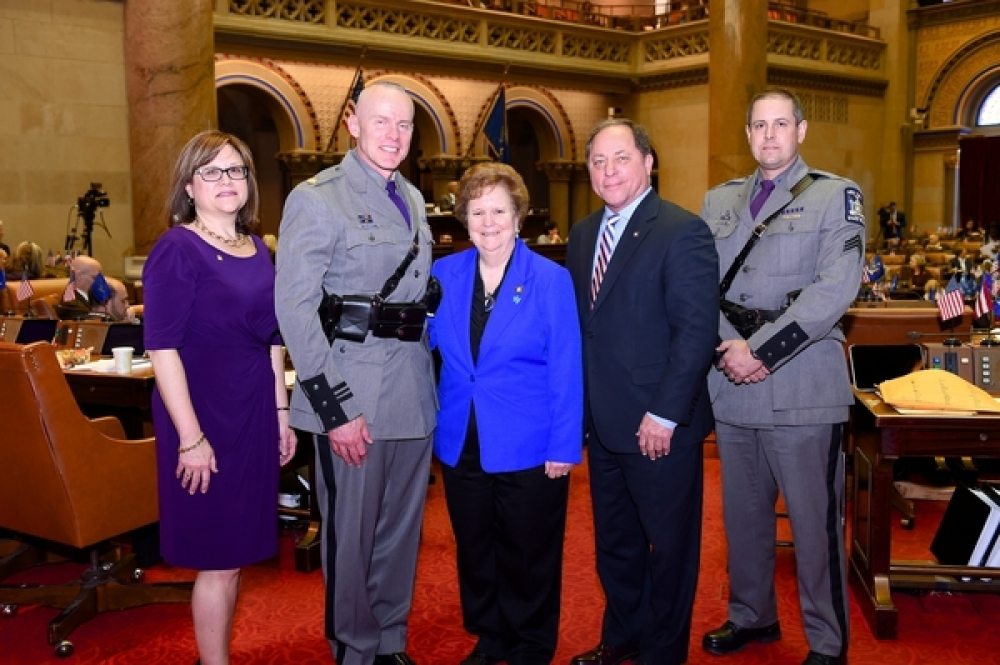 Assemblyman Steve Hawley (R,C,I-Batavia) [second from right] greets New York State Troopers Sgt. Jay Cook [far right] and Maj. Charles Guess [second from left] along with Assemblywoman Janet Duprey (R,I-Peru)[center] in Albany Monday.