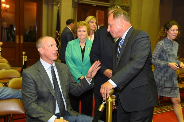 Assemblyman Steve Hawley (R,C,I-Batavia) greets former Bills Quarterback Jim Kelly in the Assembly Chamber Tuesday