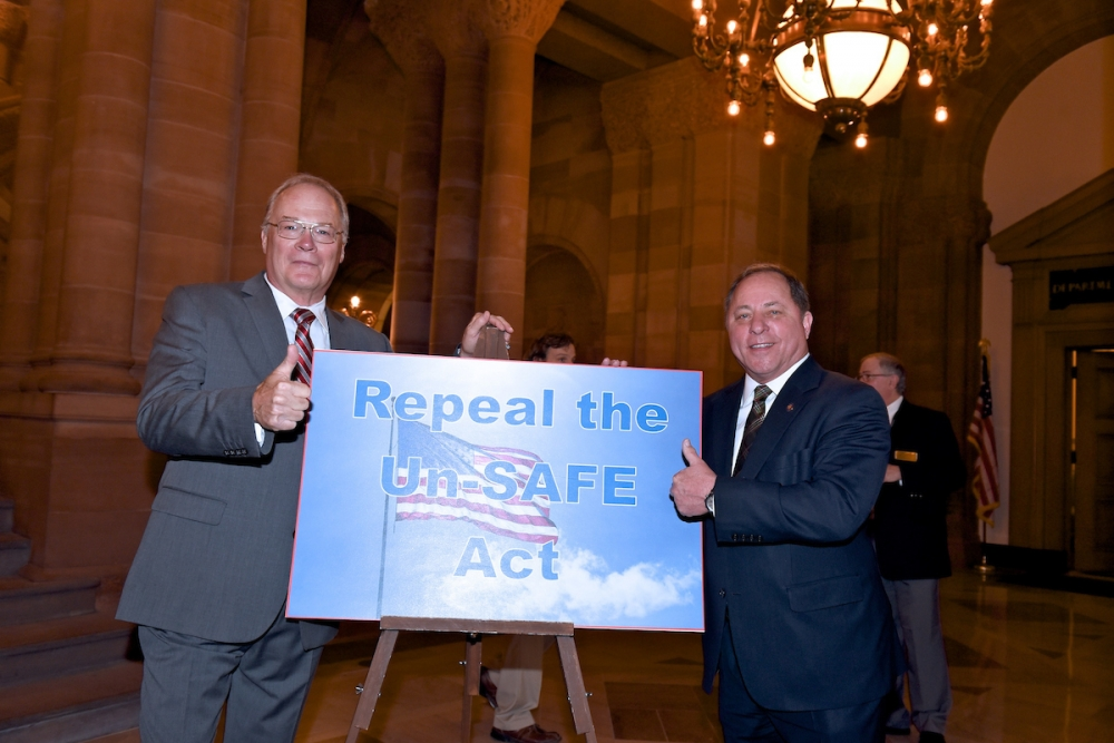 Assemblyman Steve Hawley (R,C,I-Batavia) [right] poses for a photo with New York State Rifle and Pistol Association President Tom King at today's press conference in Albany