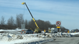 Construction crews along the Thruway repair 'I Love NY Signs' after last week's wind storm.