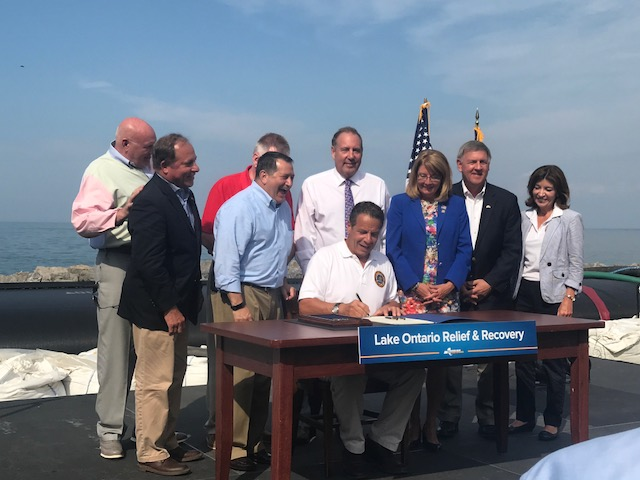 Assemblyman Steve Hawley (R,C,I-Batavia), second from the left, joins Gov. Cuomo and legislators in Irondequoit to sign a $45 million Lake Ontario relief bill into law.