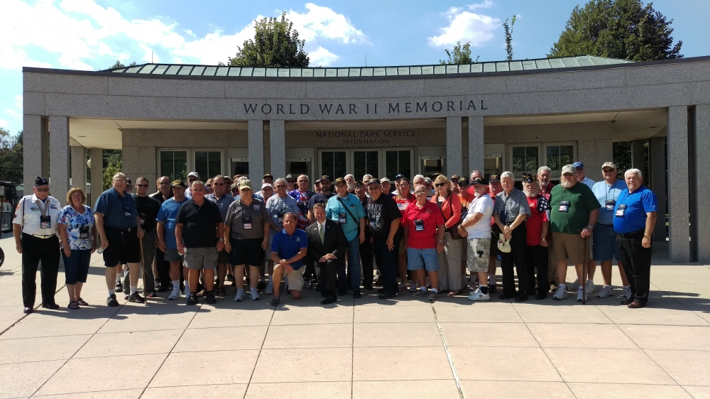 Assemblyman Steve Hawley (R,C,I-Batavia) poses with veterans and their family members in front of the World War II Memorial in Washington D.C. during a previous year's Patriot Trip