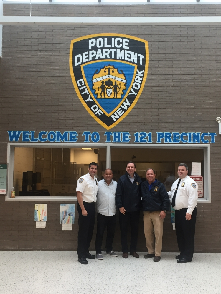 Assemblyman Steve Hawley (R,C,I-Batavia) and Assemblyman Michael Cusick (D-Staten Island) visit a local NYPD precinct on Staten Island and pose with local law enforcement members.