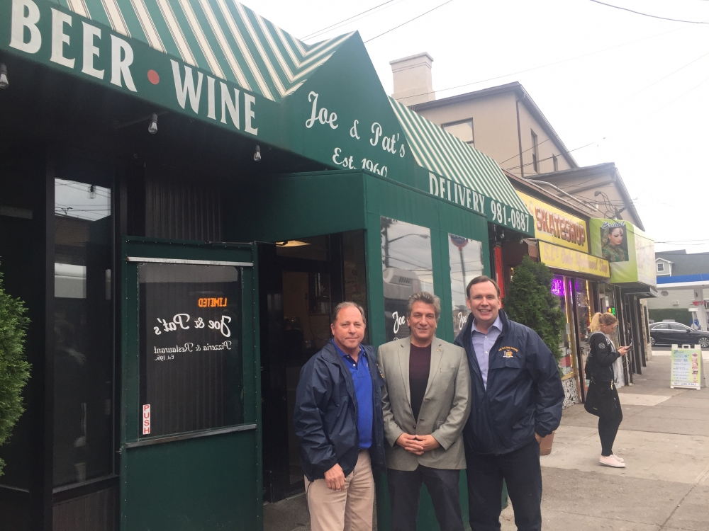 Assemblyman Steve Hawley (R,C,I-Batavia) [left], Assemblyman Matt Titone (D-Staten Island)[center], and Assemblyman Michael Cusick (D-Staten Island) [right] grab lunch at Joe & Pat's Pizza on