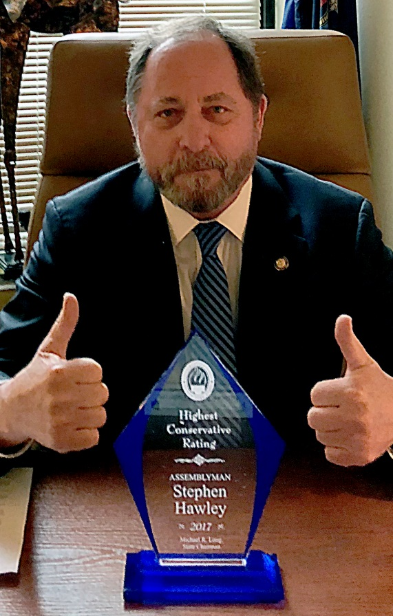 Assemblyman Steve Hawley (R,C,I-Batavia) poses with his Award as one of the most conservative members of the Assembly for 2017
