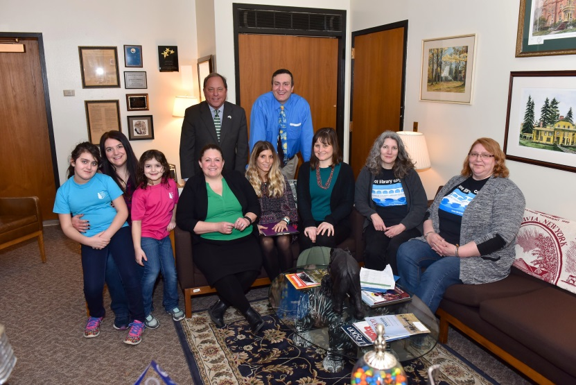 Hawley poses with representatives from the Monroe County Library system in his Albany Office