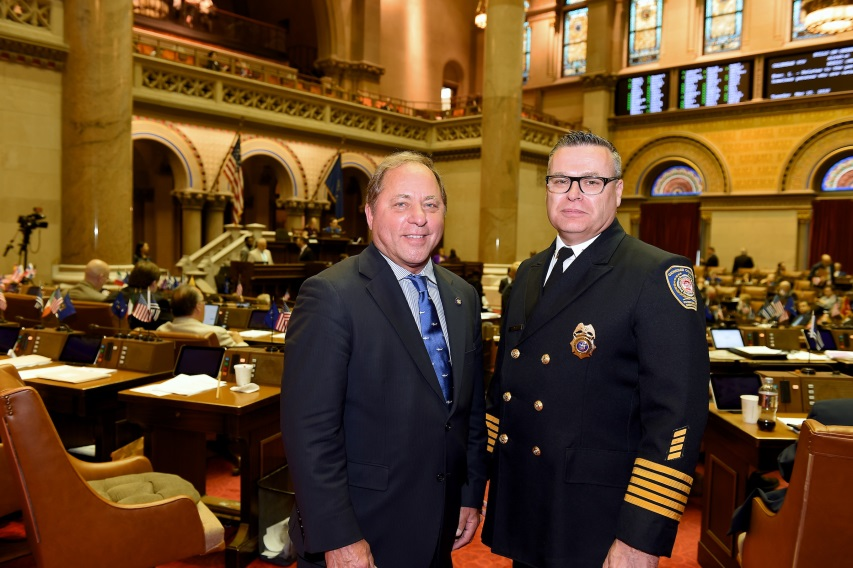 Hawley poses with Genesee County Emergency Management Coordinator Tim Yeager in the Assembly Chamber
