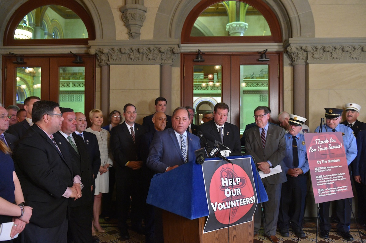 Assemblyman Steve Hawley (R,C,I-Batavia) [at podium] speaks at a press conference in Albany Monday, May 20, 2019, to unveil legislation offering a tax credit for first responders.