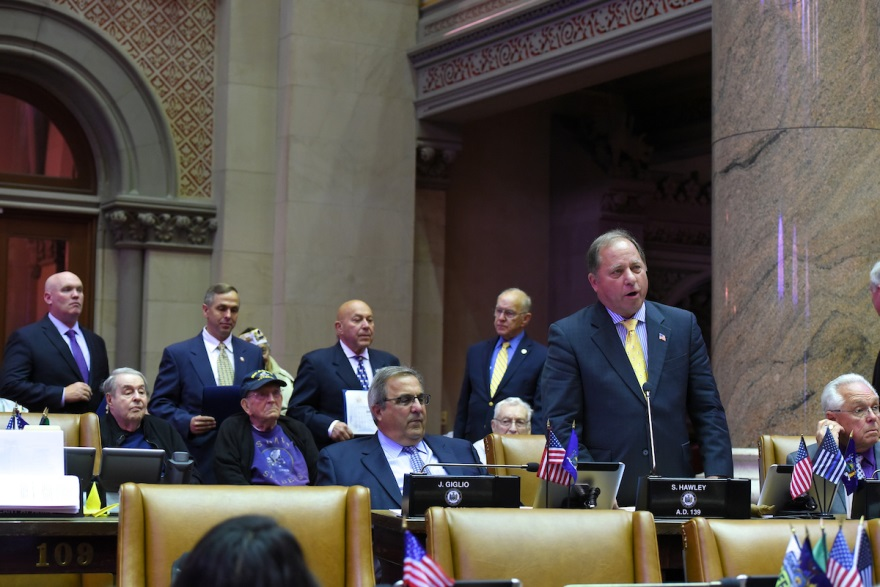 Assemblyman Steve Hawley (R,C,I-Batavia) [center] introduces several veterans of World War II on the Assembly Floor late last week.