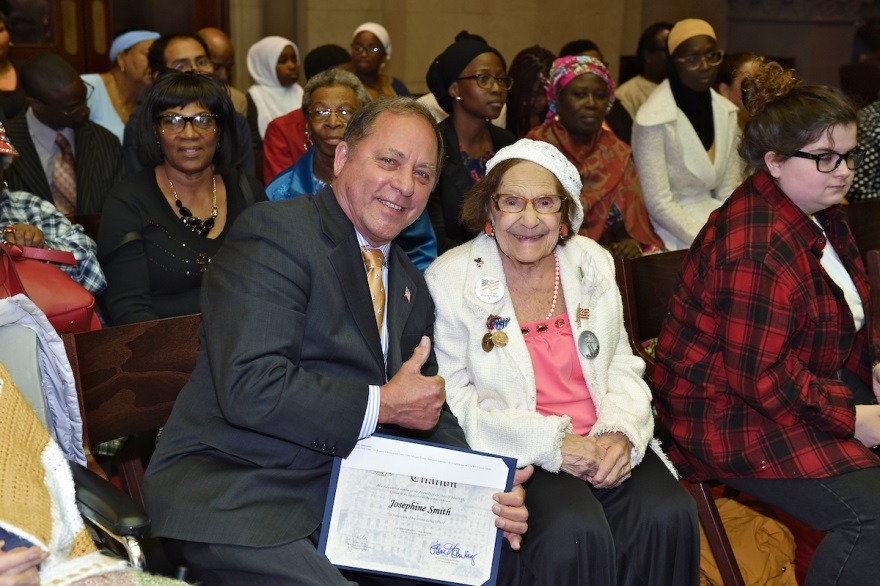 Assemblyman Hawley presents an official Assembly Citation to Josephine Smith in Albany Friday as the legislature celebrated visiting World War II veterans.