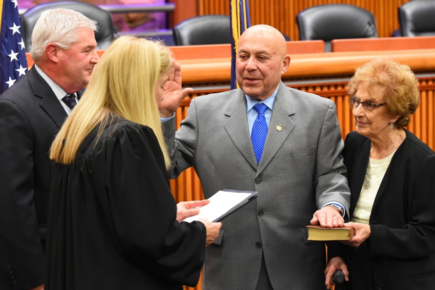 Assemblyman Angelo Morinello joined by his mother in taking his oath of office.