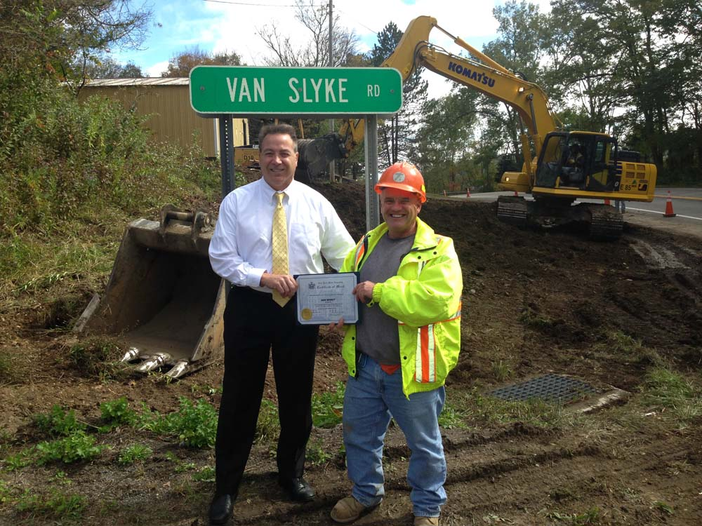 Assemblyman David DiPietro (R,C-East Aurora) is seen awarding a Citation to DOT Engineer Dan Bierut for going above and beyond the call of duty for creating a line of sight at the intersection of Route 39 and Van Slyke Road. The Van Slyke/Route 39 intersection has been the site of many accidents over the past four decades before Mr. Bierut took charge of the project and solved the problem once and for all.