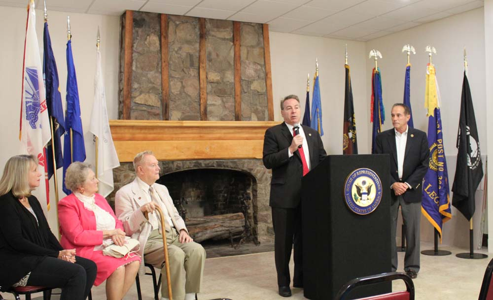 Assemblyman David DiPietro (R,C-East Aurora) addresses the audience as he joined Congressman Chris Collins (right) at the East Aurora American Legion to award Marine Corps Veteran Donald E. Schmidle (seated, left) medals he earned on behalf of our nation during World War II.