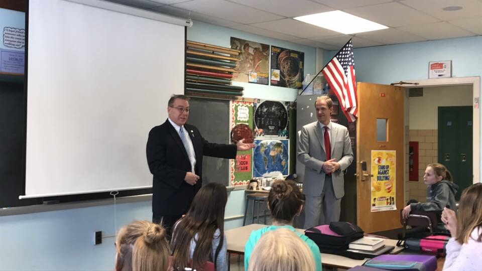 Assemblyman David DiPietro (R,C,I-East Aurora) and Sen. Patrick Gallivan explain their school supply bill to Mr. Minnuto's sixth grade class at Iroquois Middle School on December 21, 2017.
