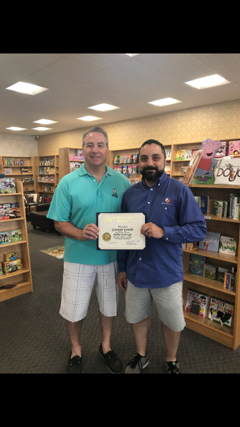 Assemblyman David DiPietro (R,C,I-East Aurora) and the new owner of Biblio Tech Café Giuseppe Gentile