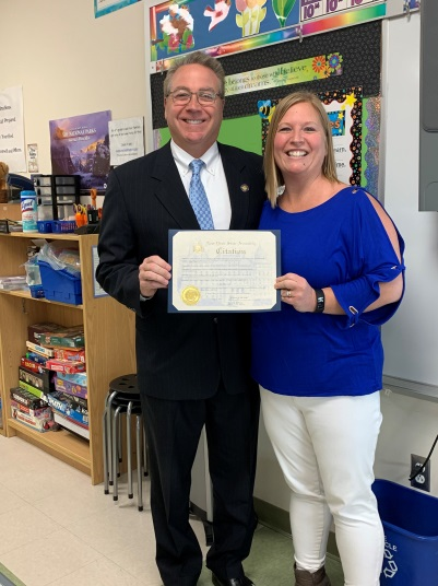 Assemblyman David DiPietro (R,C,I-East Aurora) presents the first teacher of the month award to Lisa Barron at Parkdale Elementary School in East Aurora on Friday, March 8.