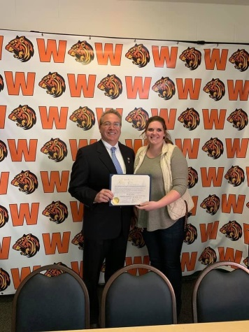 Assemblyman David DiPietro (R,C,I-East Aurora) delivering a commendation to Hannah Johnson at Warsaw High School on March 8, 2019.