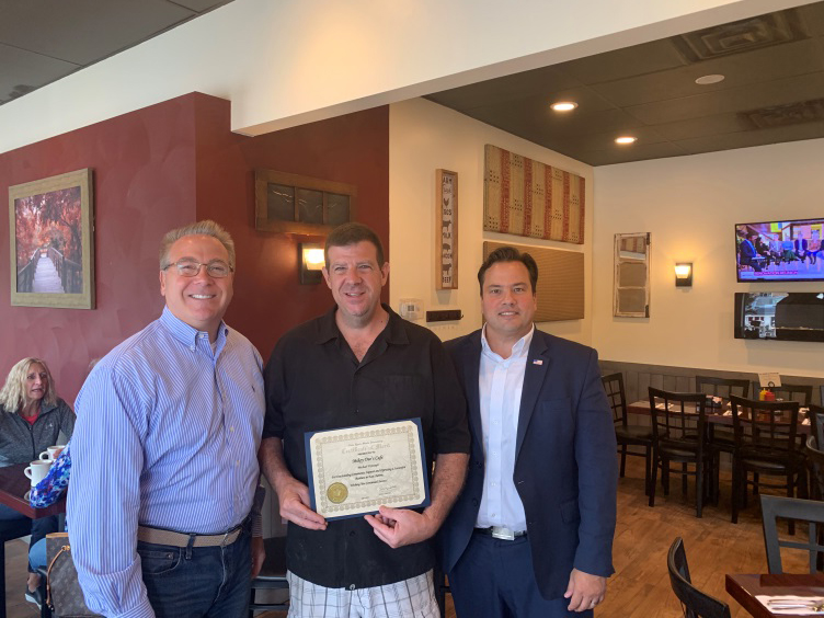 Assemblyman David DiPietro (R,C,I-East Aurora) alongside Erie County Comptroller Stefan I. Mychajliw Jr. as they honored the owner of Mikey Dee's, Michael DiJoseph, on Monday, September 9.