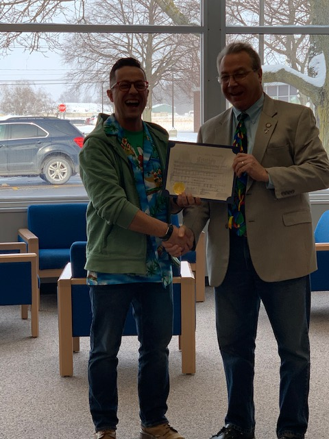 Assemblyman David DiPietro (R,C,I-East Aurora) pictured with a teacher of excellence Matthew Struzik.