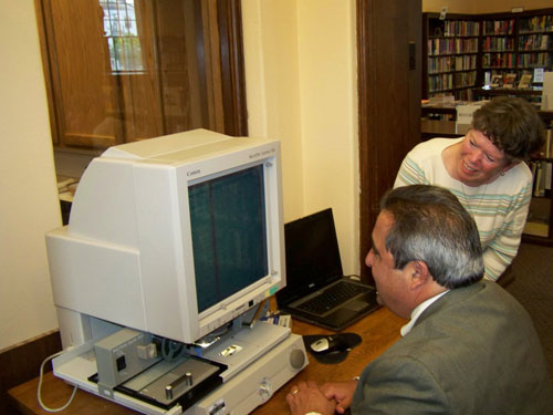 Cuba Library Director Cindy Dutton shows Assemblyman Giglio the new microfilm reader.