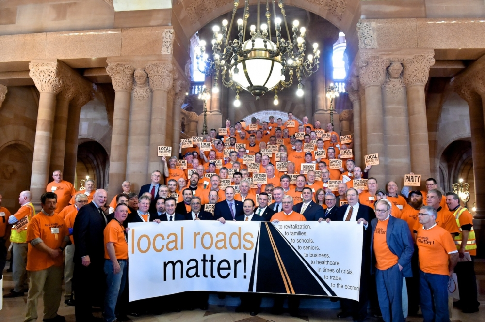 Members of the Assembly and Senate stand with town and highway workers to support funding for local roads