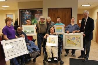 Pictured here, left to right, Terrill (Terri) Lair – Art Facilitator, Henry Wesley, Eric Barmore, Harry LaVoice, Sara Michalak – Art Facilitator, Brennan Ryel, Daniel Whitford, Eric Morrison and Assemblyman Goodell.