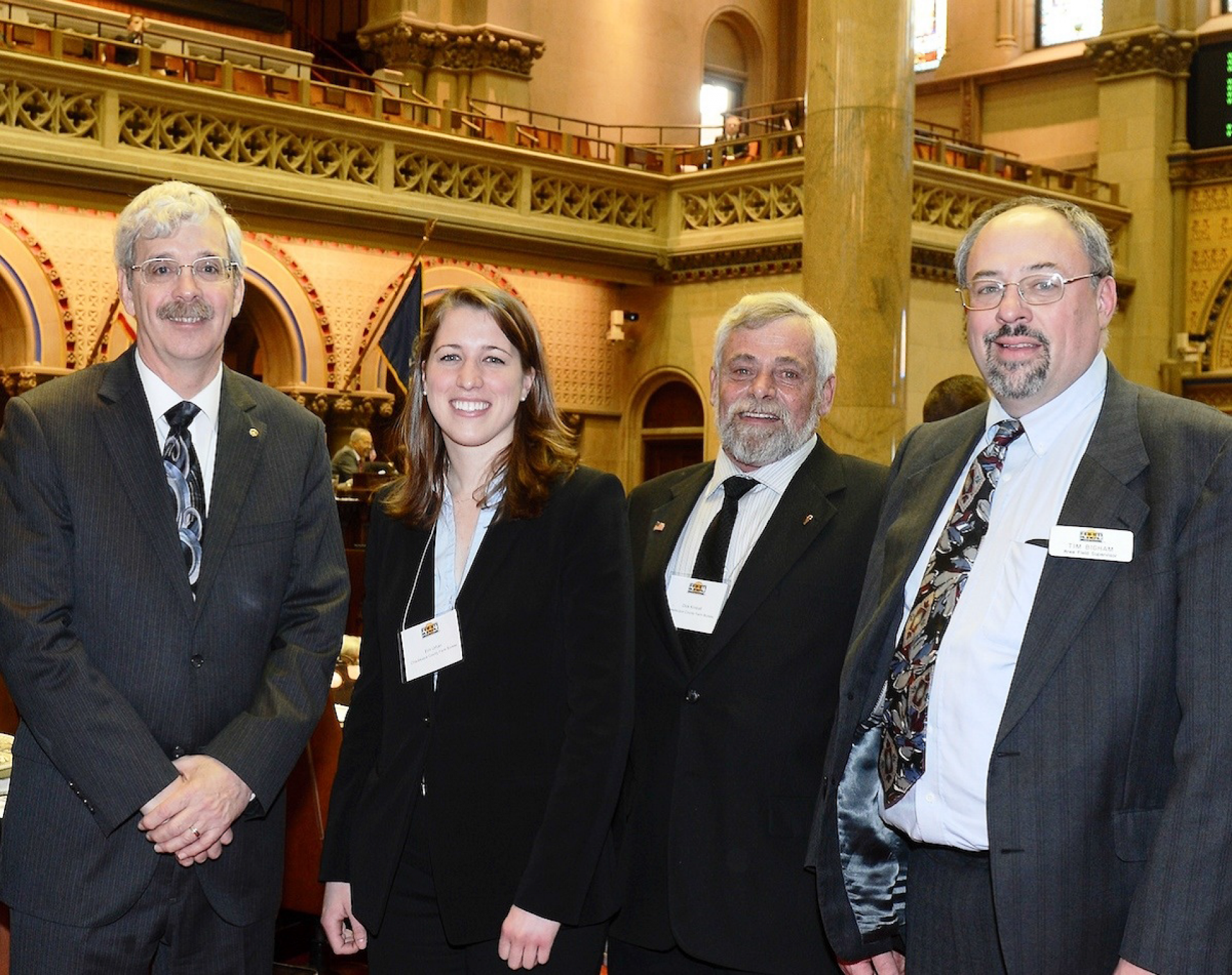 Assemblyman Andrew Goodell (R,C,I-Chautauqua) on the floor of the Assembly with Erin Urban, Chautauqua County Farm Bureau President Dick Kimball, and Farm Bureau Senior Advisor Tim Bigham.