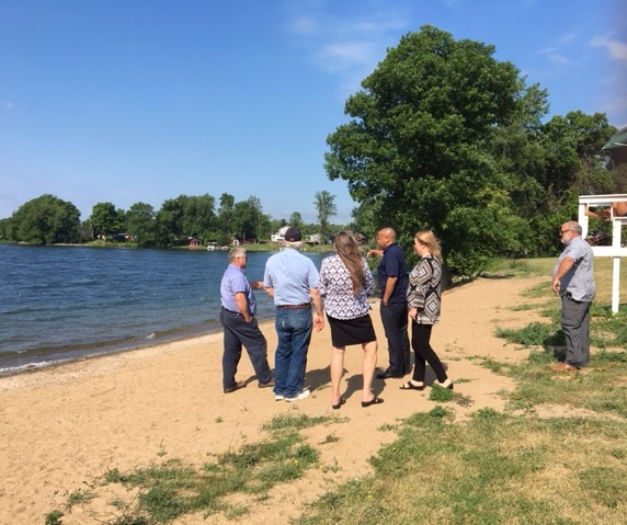 Pictured with Speaker Heastie in the first photo at Chaumont Village Beach (from left to right): Town of Lyme officials and Assemblymember Addie Jenne.