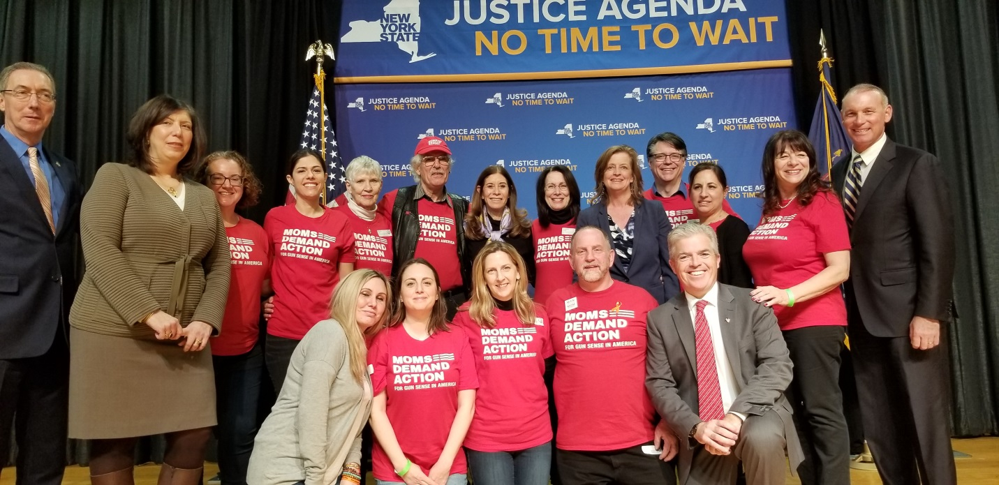 "Pictured L-R: State Senator James Gaughran, Nassau County District Attorney Madeline Singas, Linda Beigel Schulman, Assemblywoman Judy Griffin, Assemblyman Steve Stern, members of ""Moms Demand Action"" and Suffolk County Executive Steve Bellone"