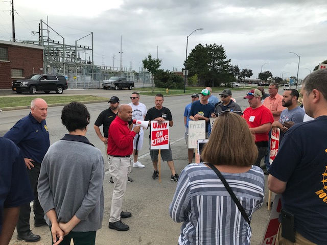 Pictured in the second photo with Speaker Heastie at the picket line in front of the Rochester GM plant are members of UAW.