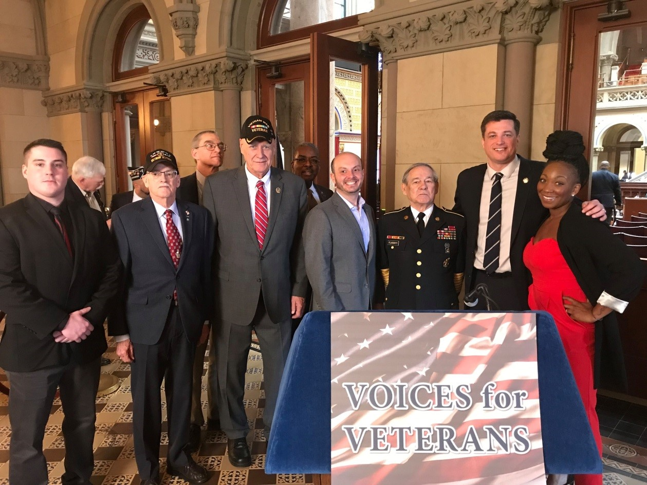 "Assemblyman Jake Ashby (R,C,I-Castleton) posing with military veterans after his ""Voices for Veterans"" kick off press conference in Albany in February 2020."